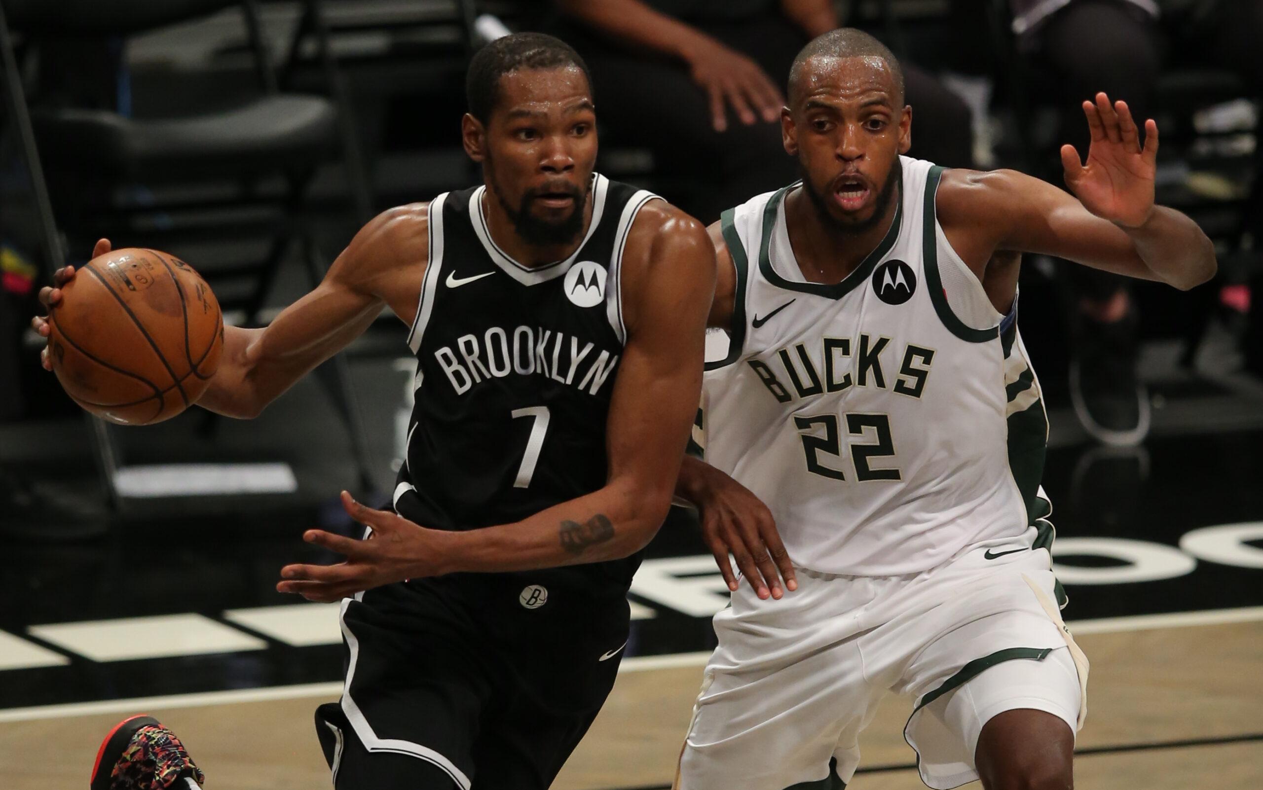 Brooklyn Nets KD drives past Middleton