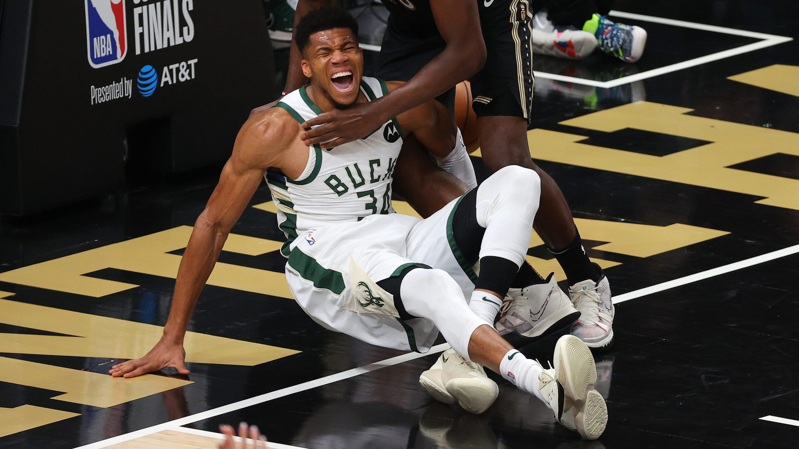 Giannis Antetokounmpo leaves Game 4 with an injury