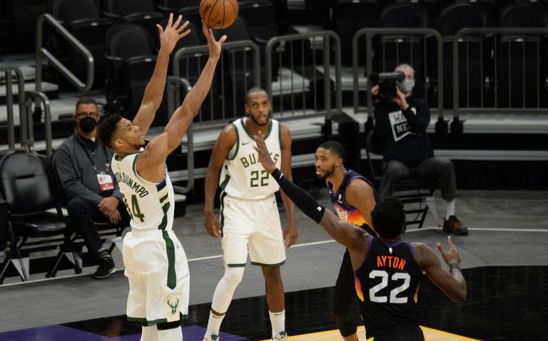 Milwaukee Bucks Greek Freak shoots over Phoenix Suns Ayton
