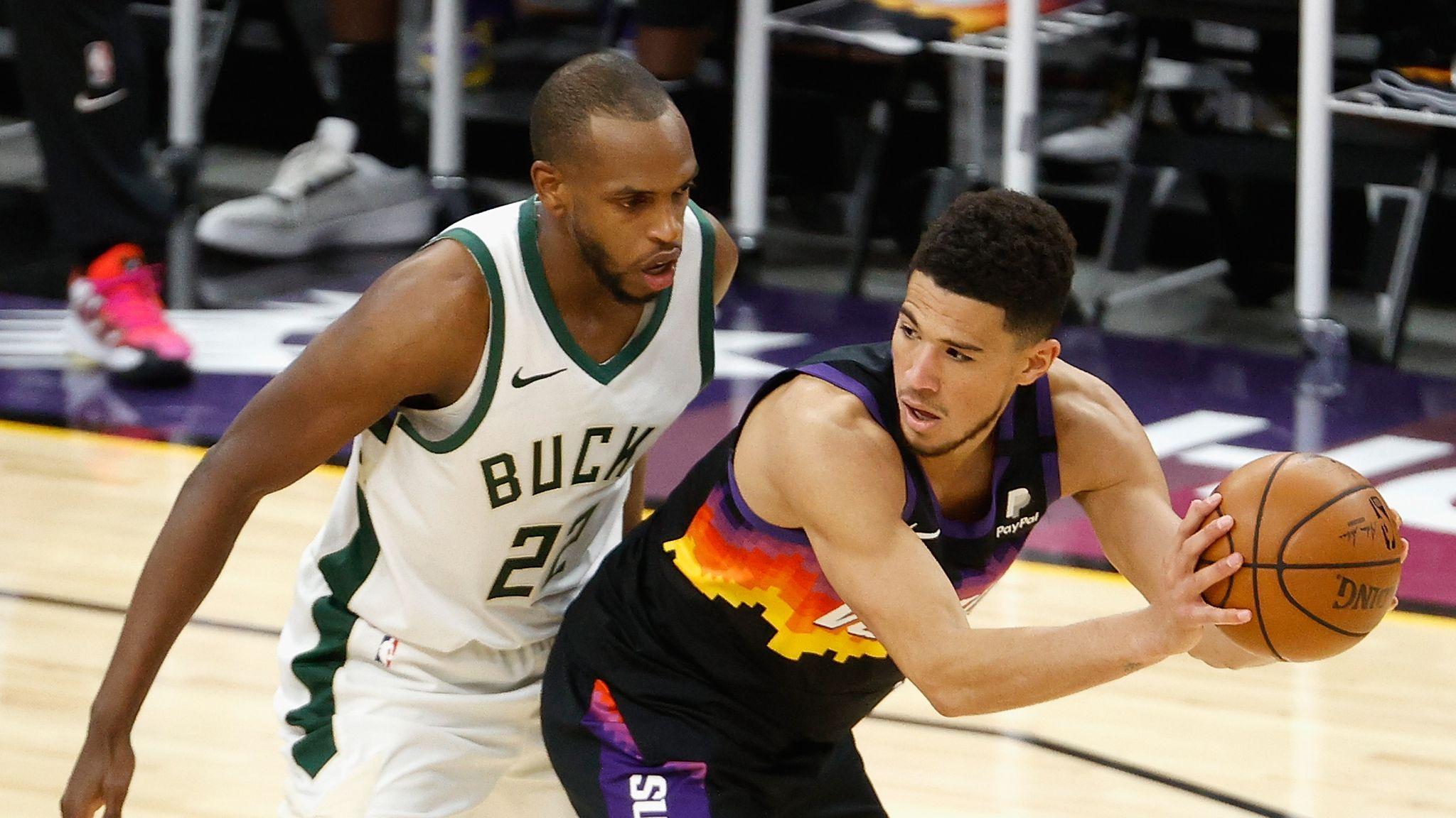 Milwaukee Bucks Middleton guarding Phoenix Suns Booker